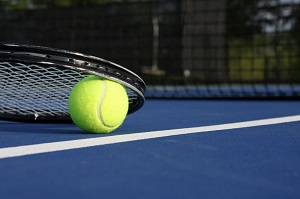 23756051 - tennis ball and racket on a blue modern court