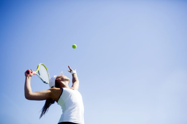 43993473 - beautiful female tennis player serving outdoor